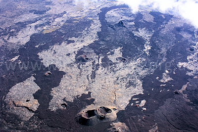 An unusual aerial view of the lava flows in the caldera of the Enclos Foucque, Piton de la Fournaise, Ile de la Reunion, September 2009