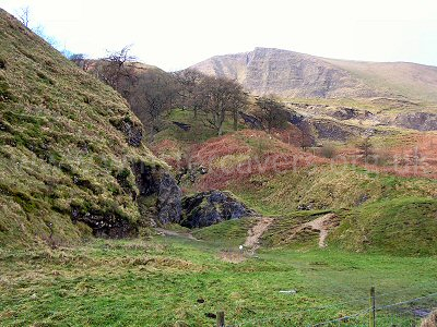The entrance ravine to Odin Mine. The approach path goes over the bracken-covered hillocks on the right of the cleft.